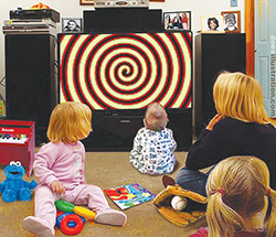 Dees-family-watching-hypnotic-TV-screen